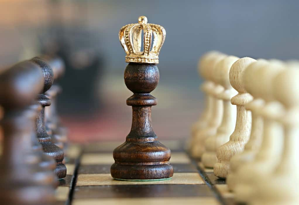 Chess pawn with a king's crown. With a solid digital marketing strategy, small businesses can defeat larger opponents.