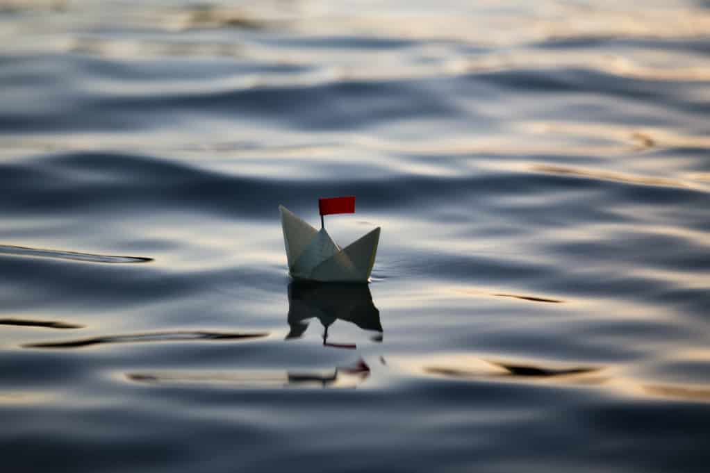 A digital marketing strategy can help small businesses stay afloat, like this small paper boat floating in water